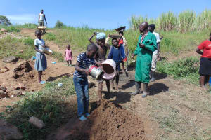 The Water Project: Mukhuyu Community, Chisombe Spring -  Community Contribution Children Bring Sand