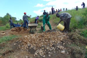 The Water Project: Mukhuyu Community, Chisombe Spring -  Mixing Concrete