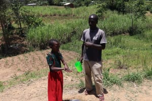 The Water Project: Mukhuyu Community, Chisombe Spring -  A Girl Demonstrating How She Normally Washes Her Hands