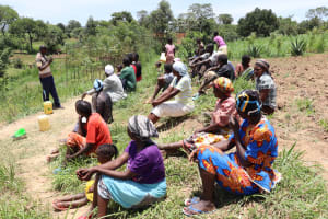 The Water Project: Mukhuyu Community, Chisombe Spring -  Training Participants Listen Keenly