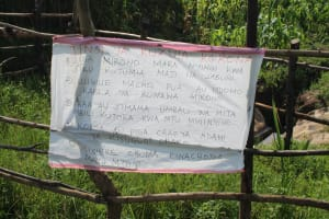 The Water Project: Mukhuyu Community, Chisombe Spring -  Reminder Chart At The Spring With Covid Regulations