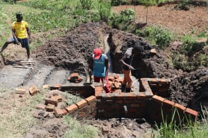 The Water Project: Mukhuyu Community, Chisombe Spring -  Wall Construction