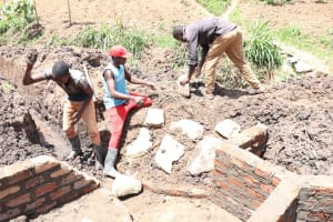 The Water Project: Mukhuyu Community, Chisombe Spring -  Stone Pitching