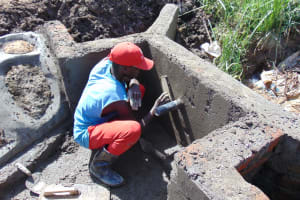 The Water Project: Mukhuyu Community, Chisombe Spring -  Outside Plaster