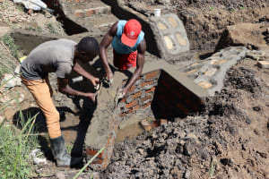 The Water Project: Mukhuyu Community, Chisombe Spring -  Wall Plaster