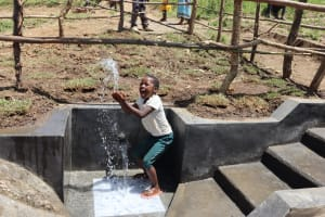 The Water Project: Mukhuyu Community, Chisombe Spring -  A Girl Splashing Water