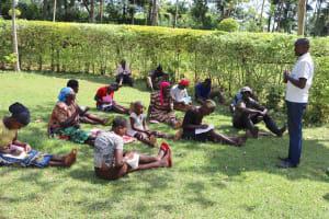 The Water Project: Harambee Community, Elijah Kwalanda Spring -  Participants Taking Notes
