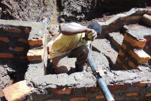 The Water Project: Harambee Community, Elijah Kwalanda Spring -  Pipe Setting