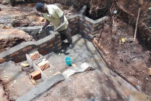 The Water Project: Harambee Community, Elijah Kwalanda Spring -  Inside Plastering Of Walls Of Escape Channels