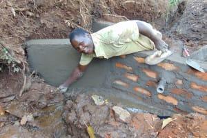 The Water Project: Harambee Community, Elijah Kwalanda Spring -  Inside Plastering Of Wing Walls And Head Wall