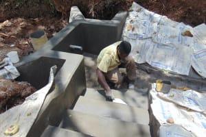 The Water Project: Harambee Community, Elijah Kwalanda Spring -  Plastering Stairs