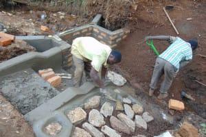 The Water Project: Harambee Community, Elijah Kwalanda Spring -  Stone Pitching