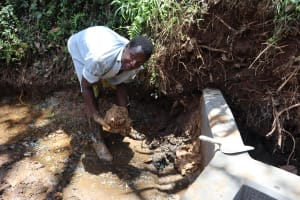 The Water Project: Harambee Community, Elijah Kwalanda Spring -  Clay Backfilling
