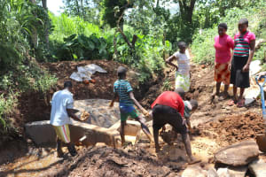 The Water Project: Harambee Community, Elijah Kwalanda Spring -  Community Members Helping With Clay Works