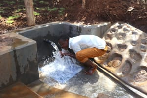 The Water Project: Harambee Community, Elijah Kwalanda Spring -  Community Member Enjoying Water