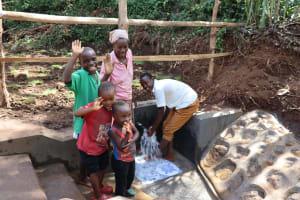 The Water Project: Harambee Community, Elijah Kwalanda Spring -  Community Members Posing