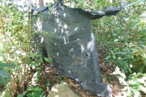 The Water Project: Mabanga Community, Ashuma Spring -  Bathing Shelter Outer Wall