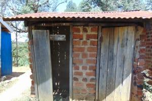 The Water Project: Ivakale Primary School & Community - Rain Tank 1 -  Latrine Block With Broken Door