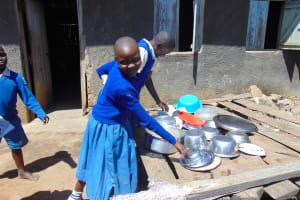 The Water Project: Ivakale Primary School & Community - Rain Tank 1 -  Reaching For A Bowl On The Dishrack