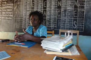 The Water Project: Ivakale Primary School & Community - Rain Tank 1 -  Teacher At Her Desk In The Staff Room