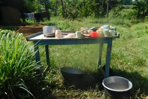The Water Project: Mahola Community, Oyula Spring -  Dishrack