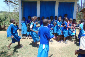 The Water Project: Ivakale Primary School & Community - Rain Tank 1 -  Running To Get In Line For The Bathroom