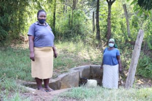 The Water Project: Shihingo Community, Mulambala Spring -  Margaret With A Community Member At The Spring