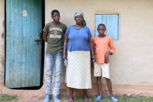 The Water Project: Shihingo Community, Mulambala Spring -  Margaret With Her Sons In Front Of Their House