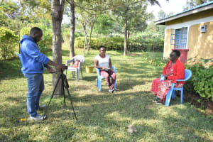 The Water Project: Ibinzo Community, Lucia Spring -  Jacky Chelagat Leading The Interview With Violet And Camera Operator Allan