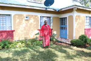 The Water Project: Ibinzo Community, Lucia Spring -  Violet Outside Her House