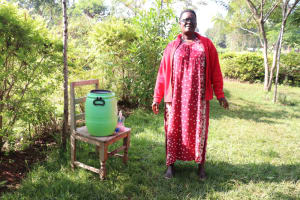 The Water Project: Ibinzo Community, Lucia Spring -  Violet Lets Her Hands Air Dry After Washing