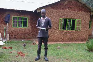 The Water Project: Shihungu Community, Shihungu Spring -  Antony Shihungu Imbai Outside His Home