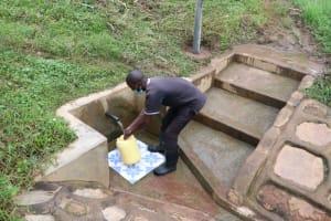 The Water Project: Shihungu Community, Shihungu Spring -  Antony Fetches Water