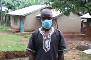 The Water Project: Shihungu Community, Shihungu Spring -  Sir Antony With His Mask On