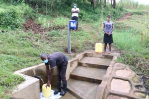 The Water Project: Shihungu Community, Shihungu Spring -  Social Distancing And Masks Are The New Norm In Public