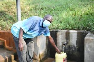 The Water Project: Shihingo Community, Inzuka Spring -  Gerald Fetching Water