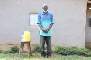 The Water Project: Shihingo Community, Inzuka Spring -  Gerald Next To His Handwashing Station