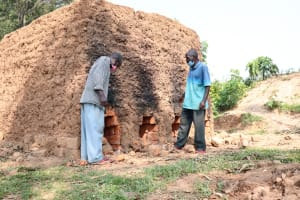 The Water Project: Shihingo Community, Inzuka Spring -  Patrick And Gerald Check On Their Bricks