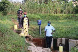 The Water Project: Shihingo Community, Inzuka Spring -  Physical Distancing At The Spring