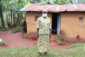 The Water Project: Mushina Community, Shikuku Spring -  Beatrice Muyonga Outside Her Home