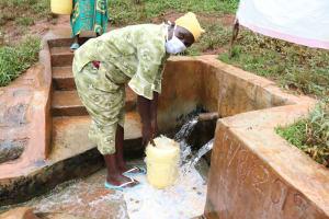 The Water Project: Mushina Community, Shikuku Spring -  Beatrice Fetches Water From Shikuku Spring