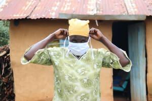 The Water Project: Mushina Community, Shikuku Spring -  Beatrice Puts On Her Mask