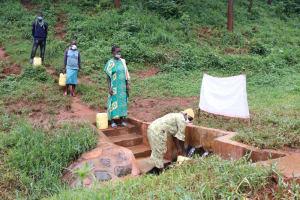 The Water Project: Mushina Community, Shikuku Spring -  Social Distancing At Shikuku Spring