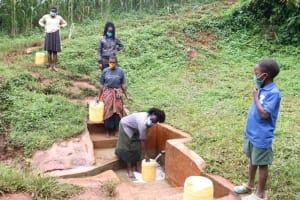 The Water Project: Hirumbi Community, Khalembi Spring -  Alice Fetching Water