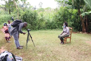 The Water Project: Hirumbi Community, Khalembi Spring -  Allan Conducts The Interview With An Audience