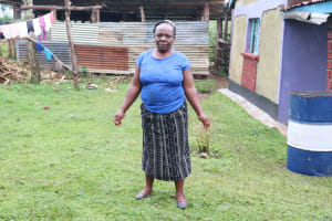 The Water Project: Ikonyero Community, Amkongo Spring -  Abigail In Front Of Her House