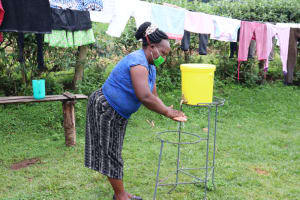 The Water Project: Ikonyero Community, Amkongo Spring -  Abigail Washes Her Hands