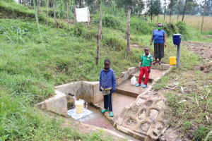 The Water Project: Ikonyero Community, Amkongo Spring -  Social Distancing At The Spring