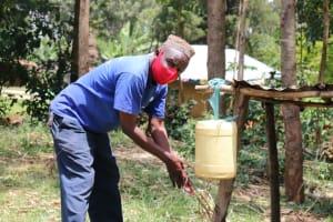 The Water Project: Buhayi Community, Nasichundukha Spring -  Joseph Handwashing At Home