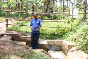 The Water Project: Buhayi Community, Nasichundukha Spring -  Joseph Posing At The Spring